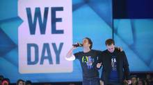Craig Kielburger, left, and his brother Marc founded We Day in 2007, and this year's version drew 20,000 people to the Air Canada Centre in Toronto on Friday. (Fred Lum/The Globe and Mail)
