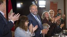 NDP leader Tom Mulcair is applauded at the beginning of their caucus meeting Wednesday, September 14, 2016 in Montreal. (Paul Chiasson/THE CANADIAN PRESS)