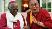 Archbishop Desmond Tutu, left, and the Dalai Lama are seen during a meeting in Cape Town in August 1996. (Mike Hutchings/Reuters)