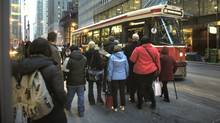 As the afternoon rush hour home begins on Nov 24 2010, commuters wait to board an eastbound King streetcar at Yonge St. in downtownToronto. (Fred Lum/The Globe and Mail/Fred Lum/The Globe and Mail)