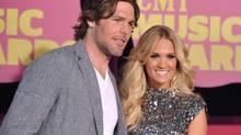 Mike Fisher, left, and singer Carrie Underwood arrive at the 2012 CMT Music Awards on Wednesday, June 6, 2012 in Nashville, Tenn. (John Shearer/AP)