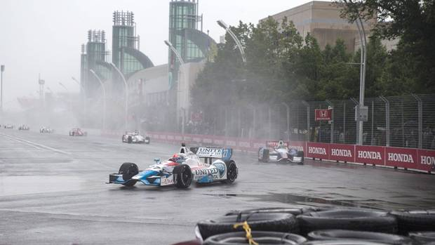 Canadian driver James Hinchcliffe takes turn one during a pace lap before the Toronto Indy was cancelled due to the weather in Toronto on Saturday July 19, 2014. (Chris Young/THE CANADIAN PRESS)