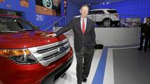 Ford CEO Alan Mulally poses at the Ford display at the North American International Auto Show in Detroit (Carlos Osorio/AP)