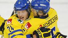 Rickard Rakell, left, and Oscar Klefbom celebrate Team Sweden's first goal against Team Canada, during first period exhibition hockey action in preparation for the upcoming IIHF World Junior Championships in Edmonton, Alta., on Friday, Dec. 23, 2011. THE CANADIAN PRESS/John Ulan (John Ulan/CP)
