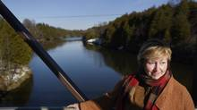 Donna McCaw stands on a footbridge that crosses the Grand River in Elora, Ont. on Nov 25 2015. McCaw is a member of a group that is challenging Nestlé Waters Canada's proposal to buy a local property and draw water from the aquifer below it to truck off site and sold as bottled water. (Fred Lum/The Globe and Mail)