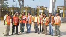 IBI Consultants pose with on-site workers at an infrastructure project site in India. (Narayanan Madhavan)