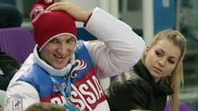 FILE - In this Tuesday, Feb. 11, 2014 file photo, Russian ice hockey player Alexander Ovechkin, left, and Russian tennis player Maria Kirilenko attend the pairs short program figure skating competition at the Iceberg Skating Palace during the 2014 Winter Olympics in Sochi, Russia. (Ivan Sekretarev/AP)