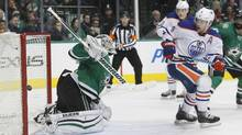 Dallas Stars goalie Antti Niemi, left, cannot stop a shot from Edmonton Oilers' Teddy Purcell (not shown) as Oilers left wing Taylor Hall (4) looks on during the second period of an NHL hockey game Thursday, Jan. 21, 2016, in Dallas. (Tim Sharp/AP)