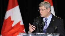 Canada's Prime Minister Stephen Harper gestures while speaking at a luncheon in Brampton March 17, 2011. (MIKE CASSESE/Mike Cassese/Reuters)