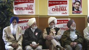 Liberal Party supporters wait for the arrival of then Prime Minister and Liberal Leader Paul Martin before the start of a campaign rally in Surrey, B.C. in May, 2004