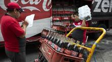 Workers make deliveries of Coca-Cola products in Mexico City, Mexico. (Susana Gonzalez/Bloomberg)