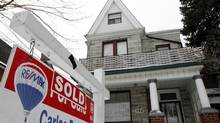 File photo of a sold sign in front of a Toronto home. (Fernando Morales/The Globe and Mail)