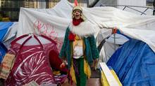 A protester dressed in a costume emerges from a tent at the Occupy Vancouver site in downtown Vancouver, B.C., on Friday November 4, 2011. Fire officials ordered the removal of unoccupied tents and overhead tarps at the site, citing safety concerns. (THE CANADIAN PRESS/Darryl Dyck) (DARRYL DYCK/THE CANADIAN PRESS)