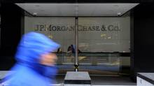 A pedestrian passes by JPMorgan Chase & Co. offices in New York in this file photo. (Peter Foley/Bloomberg)