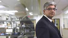 Dr. Nizar N. Mahomed, Head, Division of Orthopaedic Surgery at Toronto Western Hospital, is photographed by the laboratories at the Buchan Arthritis Research Centre in the Krembil Discovery Tower, part of Toronto Western Research Institute, on Jan 8 2015. (Fred Lum/The Globe and Mail)