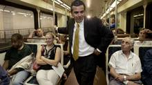 Los Angeles Mayor Antonio Villaraigosa talks to subway riders, July 7, 2005, in Los Angeles. (NICK UT/Nick Ut/Associated Press)