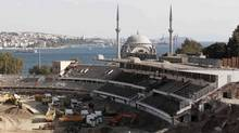 A general view of the construction of soccer club Besiktas' Inonu Stadium is seen in Istanbul September 1, 2013. Along the picturesque Bosphorus Straits dividing Europe and Asia, Istanbul is undergoing a transformation which should fill Turkey with confidence in its bid to become the first Muslim country to stage the Olympics in 2020. Overlooking the waterway, mechanical diggers are tearing down Besiktas' Inonu Stadium to make way for a state-of-the-art facility earmarked to stage rugby in 2020, and to the north construction of the city's third suspension bridge is underway. (OSMAN ORSAL/Reuters)