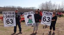 Protesters hold signs at a rally in Fort McMurray, Alta. Saturday, May 5, 2012. Organizers say almost 2,000 people rallied to push the Alberta government to quickly finish twinning a dangerous highway that was the scene of a horrific crash. Seven people died in the crash on Highway 63, the main route between Edmonton and the oilsands capital of Fort McMurray. (Carl Longe/The Canadian Press/Carl Longe/The Canadian Press)