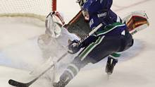 Minnesota Wild goalie Niklas Backstrom stops Vancouver Canucks forward Ryan Kesler during the third period in Vancouver on Saturday. (DARRYL DYCK)