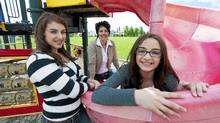 Carla Mosca with her daughters Lexi (L) 13 and Giulianna 10 at the school playground in Calgary, Alberta, June 12, 2011. (Todd Korol for The Globe and Mail/Todd Korol for The Globe and Mail)
