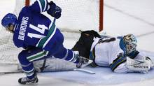 San Jose Sharks goaltender Antti Niemi stops a shot from Vancouver Canucks' Alex Burrows (L) during a shoot-out for their NHL hockey game in Vancouver, British Columbia, January 2, 2012.REUTERS/Ben Nelms (Ben Nelms/Reuters)
