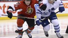 Ottawa Senators' Zack Smith (15) under pressure from Toronto Maple Leafs' Tyler Bozak during second period NHL action in Ottawa Saturday, April 20, 2013. (Justin Tang/THE CANADIAN PRESS)