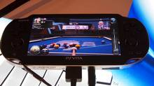 Game blogger Chad Sapieha lines up a shot in Hustle Kings, a billiards game for the PlayStation Vita. (Chad Sapieha)