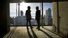 Vice president Shamez Virani, left, president Andrew Hoffman of CentreCourt Developments are photographed at one of theircondo developments located at Adelaide and Peter Street in Toronto. (Kevin Van Paassen/The Globe and Mail)