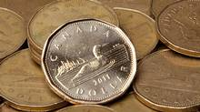 Canadian dollar coins. (JONATHAN HAYWARD/THE CANADIAN PRESS/JONATHAN HAYWARD/THE CANADIAN PRESS)