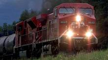 A Canadian Pacific Railway train makes its way through the Alberta Rockies in August of 2001. (ADRIAN WYLD/The Canadian Press)