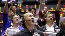 Traders relay a trade on the floor of the Chicago Board of Trade. (JOHN GRESS/REUTERS)