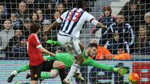 West Bromwich Albion's Solomon Rondon beats Manchester United goalkeeper David De Gea for the only goal scored during a 1-0 match, at the Hawthorns in West Bromwich, England, on March 6. (Rui Vieira/AP Photo)