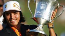 Rickie Fowler of the U.S. holds up the trophy after winning the Wells Fargo Championship PGA golf tournament in Charlotte, North Carolina May 6, 2012. REUTERS/Chris Keane (CHRIS KEANE)