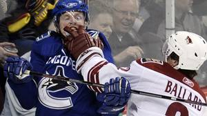 Defenseman Keith Ballard #2 of the Phoenix Coyotes (R) gets in the face of center Henrik Sedin #33 of the Vancouver Canucks (L) during their game at General Motors Place on March 17, 2008 in Vancouver, Canada. (Photo by Nick Didlick/Getty Images)