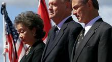 Then U.S. Ambassador to Canada Paul Cellucci, right, Prime Minister Jean Chrétien and Governor-General Adrienne Clarkson attend a ceremony in Ottawa marking a day of mourning for the victims of the 9/11 attacks on the United States, September 14, 2001. (JIM YOUNG/REUTERS)