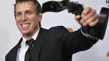 James Duthie poses with his award for at the 26th Gemini Awards in Toronto September 7, 2011. (STRINGER/CANADA/REUTERS)