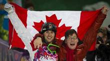 Alex Bilodeau pose with his brother Frederic after winning gold in the men's freestyle moguls event at the Sochi Winter Olympics February 10, 2014. (John Lehmann/Globe and Mail)