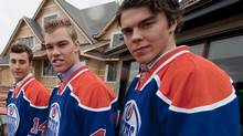 Edmonton Oilers' rookies Jordan Eberle, left, Taylor Hall, centre, and Magnus Paajarvi pose in front of a show home that will be won by a lucky lottery winner, with the proceeds going to the Edmonton Oilers Community Foundation charity, after a team press conference on Wednesday, September 8, 2010. Oilers have one main goal in 2010-11: protect and develop rookie whiz kids Hall, Eberle and Paajarvi.Anything else is gravy for a team that finished dead last in the NHL last season and has finally given up the pretension it's one or two big-name free-agent signings away from the playoffs. THE CANADIAN PRESS/John Ulan (John Ulan)