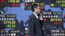 An electronic board displays global market indexes outside a brokerage in Tokyo, Aug. 23, 2012. Foreigners purchased more than a $1-billion (U.S.) in Japanese equities last week. (YURIKO NAKAO/REUTERS)