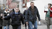 Prominent anti-corruption blogger Alexei Navalny (centre) arrives for an appeal hearing at a court in Moscow Dec. 7, 2011. (DENIS SINYAKOV/DENIS SINYAKOV/REUTERS)
