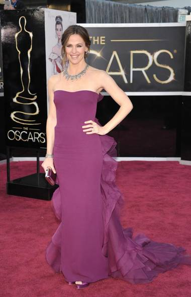 Jennifer Garner's plum Gucci looked nice enough on top, until she turned around, revealing a mass of misguided plumage-like ruffles. Two words: fashion mullet. And one more: no. (John Shearer/AP)