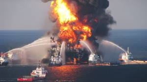 Fire boats battle a fire at the off shore oil rig Deepwater Horizon April 21, 2010 in the Gu
