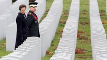 Princess Anne is guided by Chief Warrant Officer David Snyder through the Canadian National Military Cemetery in Ottawa on Monday. Princess Anne is guided by Chief Warrant Officer David Snyder, through the Canadian National Military Cemetery in Ottawa, Monday November 10, 2014. THE CANADIAN PRESS/Fred Chartrand (FRED CHARTRAND/THE CANADIAN PRESS)