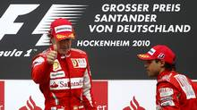 Ferrari Formula One drivers Fernando Alonso and Felipe Massa stand on the podium at the German Grand Prix in this July 25, 2010 file photo. Alonso's Formula One title hopes could suffer a knockout blow when the sport's governing body decides Ferrari's fate at a Paris hearing on September 8. The Italian team has already been fined $100,000 for manipulating the German Grand Prix in July through the use of banned 'team orders'. (Kai Pfaffenbach/Reuters)
