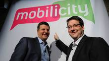 DAVE Wireless becomes Mobilicity: Chairman John Bitove (left) and President Dave Dobbin unveil Mobilicity, the companys go-to-market consumer brand name, at a press conference in Toronto, Tuesday, February 2, 2010. (Derek Oliver)