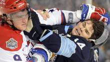 Pittsburgh Penguins left wing Chris Kunitz (14) and Alex Ovechkin (L) of the Washington Capitals fight during the third period of the the NHL's Winter Classic hockey game at Heinz Field in Pittsburgh, Pennsylvania January 1, 2011. REUTERS/Dave Denoma (DAVID DENOMA)