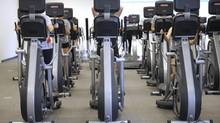 The cardio room was packed on the second day the Centre opened with elliptical trainers and treadmills being used. (Fred Lum/The Globe and Mail)