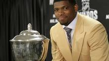 Montreal Canadiens defenseman P.K. Subban poses with the James Norris Memorial Trophy as the League's outstanding defenseman in Chicago, Illinois, June 15, 2013. There have been reports that team selectors for the 2014 Sochi Olympics are wary of Subban's spectacular but risk-taking style on defence. (JOHN GRESS/REUTERS)