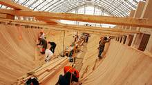 Workers line the hull of the schooner Bluenose II during the famed vessels refit in Lunenburg, NS, May 12, 2011. (Paul Darrow/The Globe and Mail)