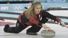Canada's skip Jennifer Jones delivers a stone during their women's curling round robin game against South Korea at the Ice Cube Curling Center during the 2014 Sochi Winter Olympic Games February 17, 2014. (INTS KALNINS/REUTERS)